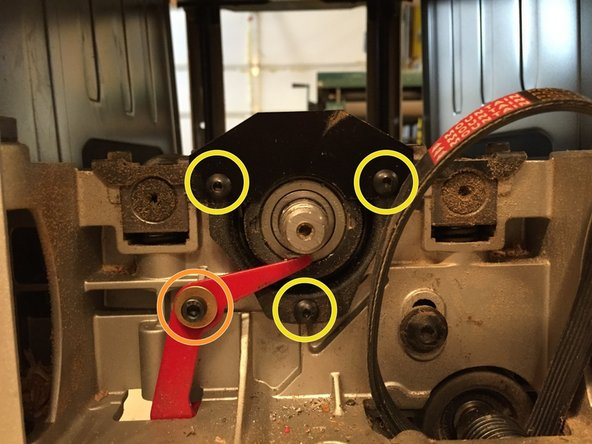 Remove three M5 x 16mm screws using a 3mm allen wrench. The belt dust shield plate  is attached with the top two screws.