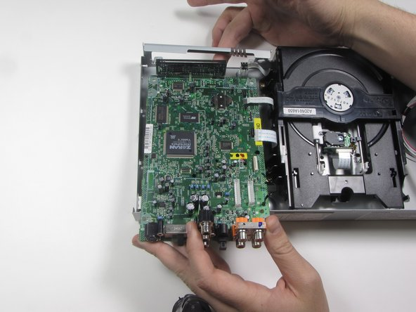 Lift the motherboard from the rear and pull backwards (towards you) to remove entirely from the casing.