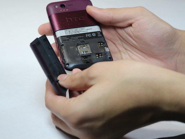 Slide the bottom back casing off the phone.