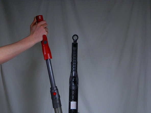 Locate the removable hose on the back of the Dyson.