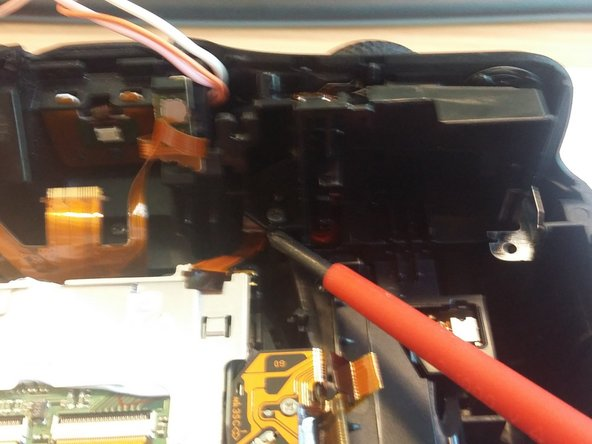 Remove two screws mounting plastic buttons module.