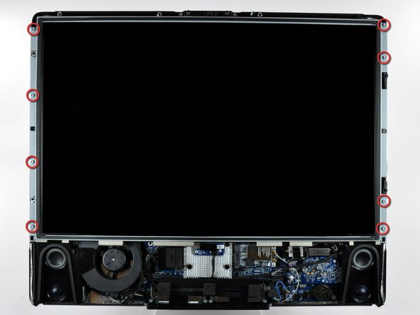Remove the eight 12 mm T8 Torx screws securing the display panel to the rear case.