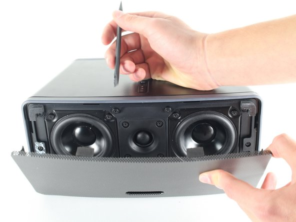 Gently pull the screen away from the body of the speaker, revealing the tweeter and two mid-range drivers behind it.
