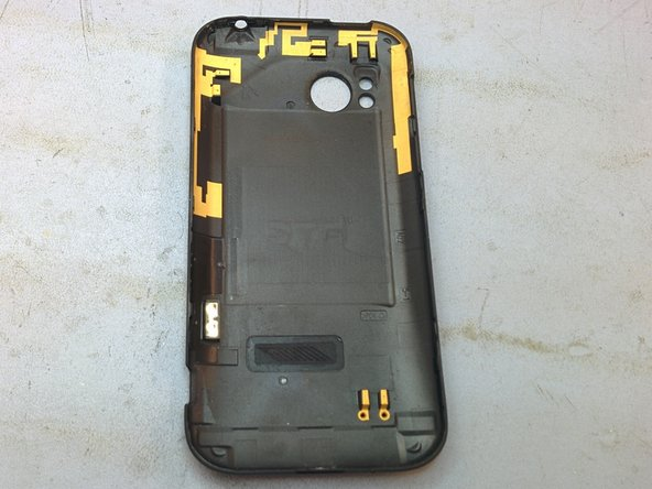 Remove rear cover using little notch located at bottom of phone