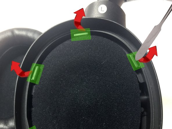 Use a spudger to pry the six notches holding the foam cup from the headphone.