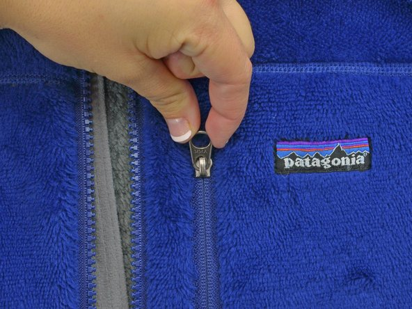 Image 2/2: Lift up the zipper, as if you were pulling the zipper closed.