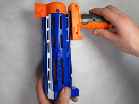 Slide the hand grip assembly forward off of the barrel assembly.