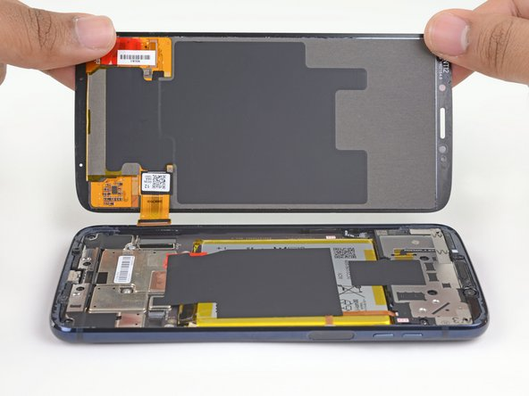 Gently lift the display, making sure the display cable slides smoothly out of its socket.