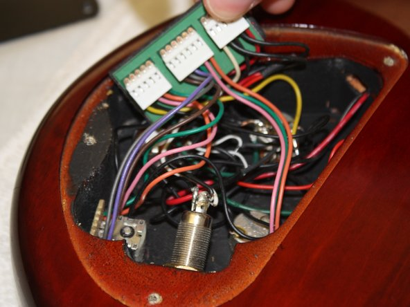 ibanez 5 string bass model sr405qm output jack replacement ifixit image 1 3 locate the output jack at the base of the cavity