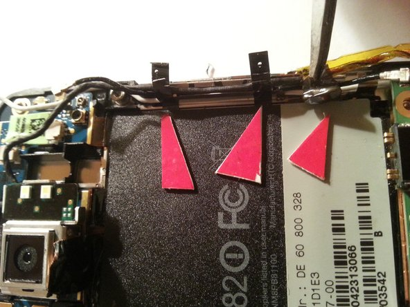 Using tweezers, release the 3 tesa strips.