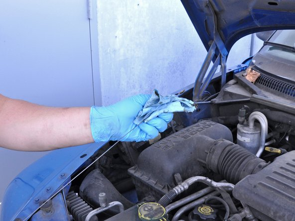 Pull out the oil dipstick, wipe it off, place it all the way back into its hole, and remove it again.