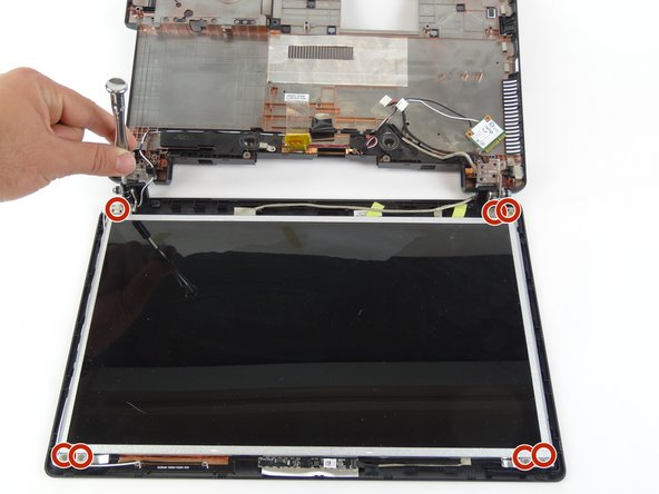 Remove eight 4mm screws from the corners of the screen using a JIS #000 screwdriver.