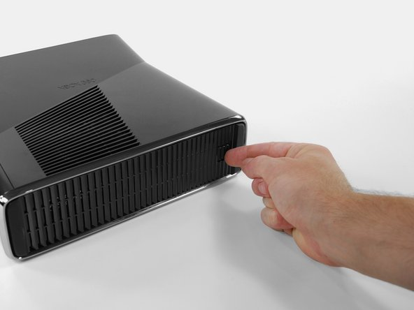 Image 1/3: Orient the Xbox 360 S so that the bottom of the console is facing toward you.
