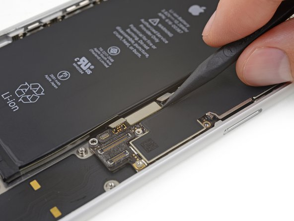 Use the point of a spudger to pry up and disconnect the Lightning connector assembly's flex cable from the logic board.