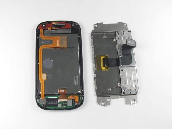 Image 2/2: Separate the display flex cable from the LCD cover plate.