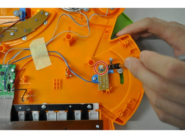 Remove PH2 screw (5 mm) from yellow/gold colored circuit board and pull back to access the whammy component.