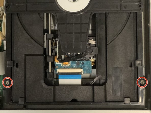 Use a Phillips #1 screwdriver to remove the two screws that secure the Optical Drive.