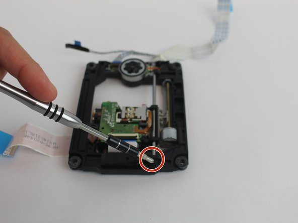 Remove the 10 mm screw using head #J1 screwdriver.