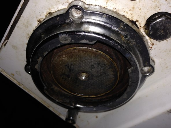 Image 3/3: There are 4 screws holding the outer ring in place, unscrew those and the outer ring should come free.