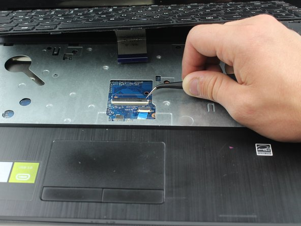Then pull the ribbon from the connector and remove the keyboard from the laptop.