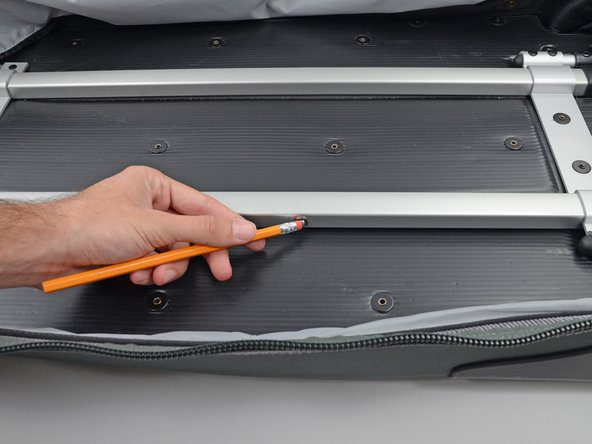 Image 2/3: If either pin is not retracting use a pencil, screwdriver, or other thin object to push the pin into the hole.