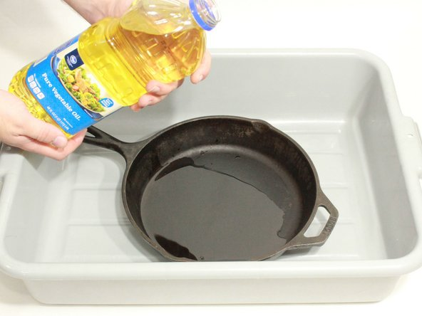 Image 1/3: Spread the oil evenly across the surface of the pan.
