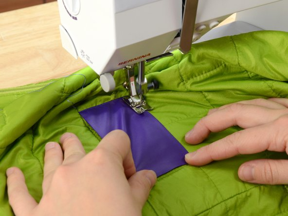 Image 3/3: Be sure to hold the patch in place as you sew.