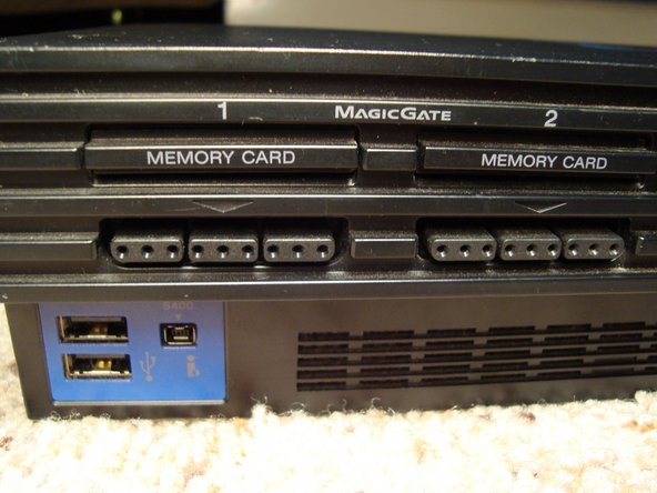 On the front left side we can see the two USB ports and the Firewire port. Two memory card slots, and the two controllers inputs.