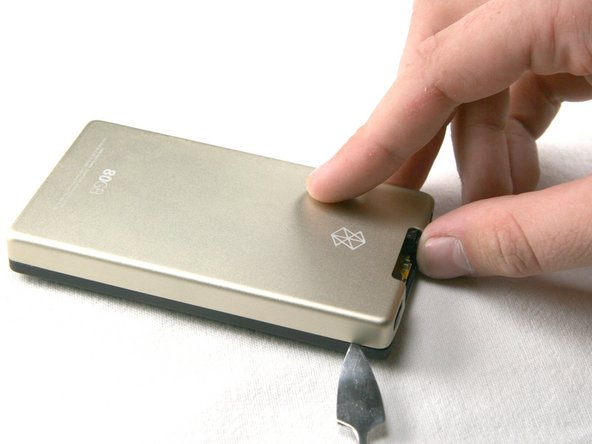 Image 1/3: Be careful not to press the tools in too far; there are exposed cables right inside the edge of the device.