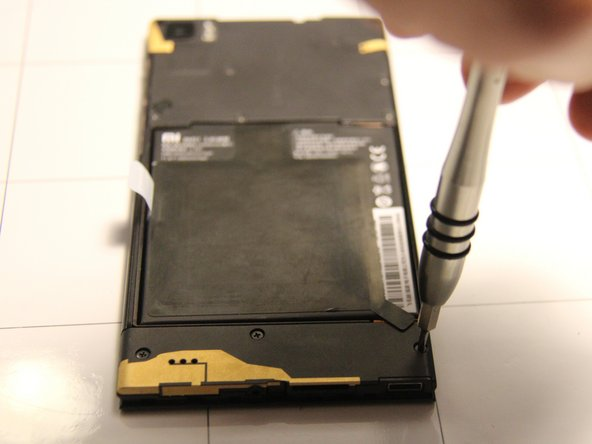 Next, remove the three screws located at the bottom of the back panel of the phone.