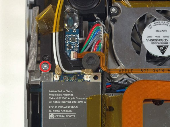 Image 1/1: Remove the single silver Phillips screw located just above the Airport Extreme card.
