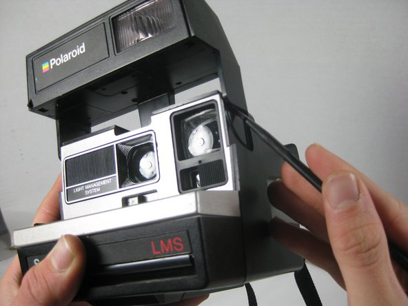 Use a spudger on each side to separate the flash segment from the main body.