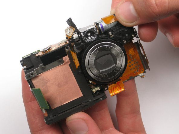 Remove the lens carefully from the chassis. You're done!