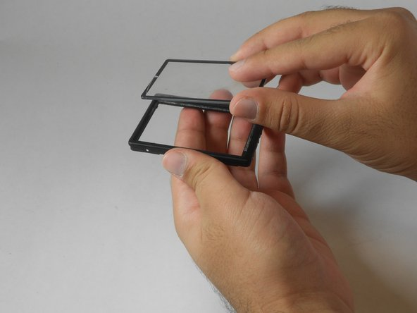 Image 2/2: To place a new plastic cover, simply stick it to the frame in the appropriate position.