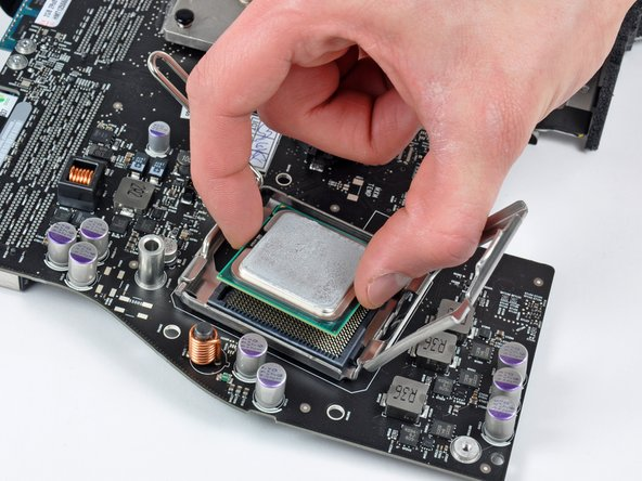Carefully lift the CPU straight up off its socket.