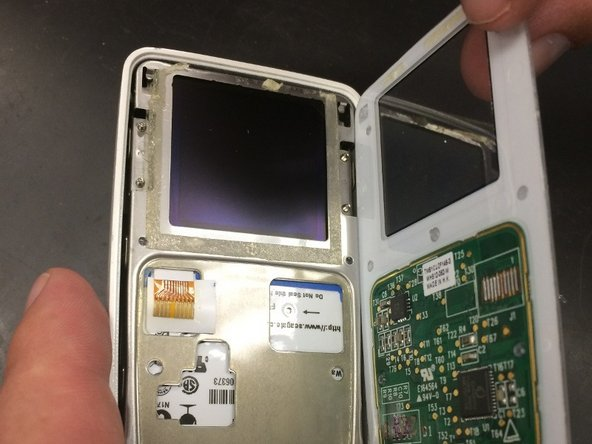 Slowly detach the front cover from the rest of the device to reveal the interior.
