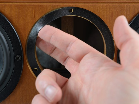 Use your fingers to loosen the sealing ring that's now visible in the cabinet opening.