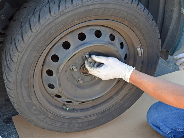 Hand tighten each of the five lug nuts.