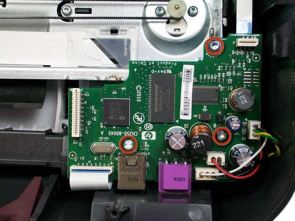 Using a T-10 Torx screwdriver, unscrew the three 1/2'' screws on the motherboard.