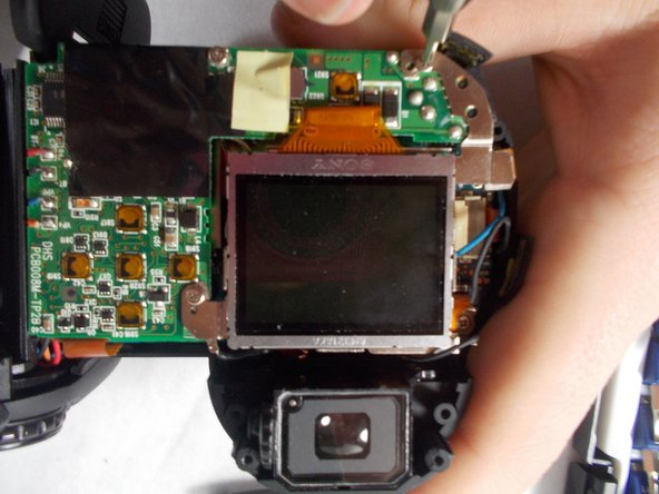 Remove the 3 screws that attach the LCD screen to the circuit board.