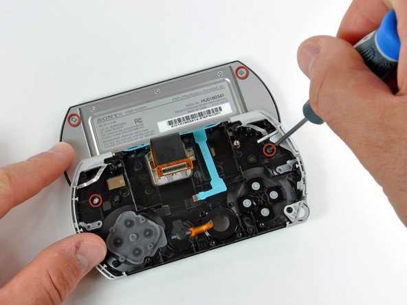 Use a #00 Phillips screwdriver to remove the four display screws.
