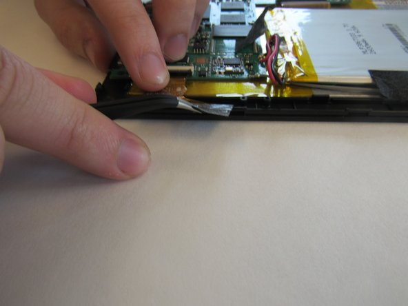 Using the tweezers, remove the black tape connecting the screen to the motherboard.