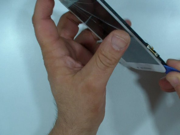 With a plastic tool start the separation at the upper side.