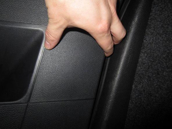 Using your fingers, gently pull the cover away from the compartment.