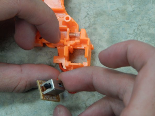 Image 2/2: To remove use two fingers to pry the plastic edges apart and with your thumbs remove the circuit board. Having a friend help with this step could be beneficial.