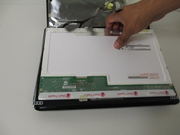 Simply lift the screen from back of the laptop to remove it