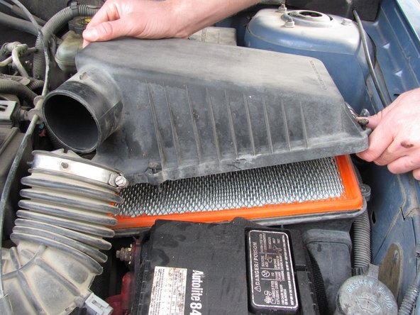 Gently lift the top off of the air intake box.