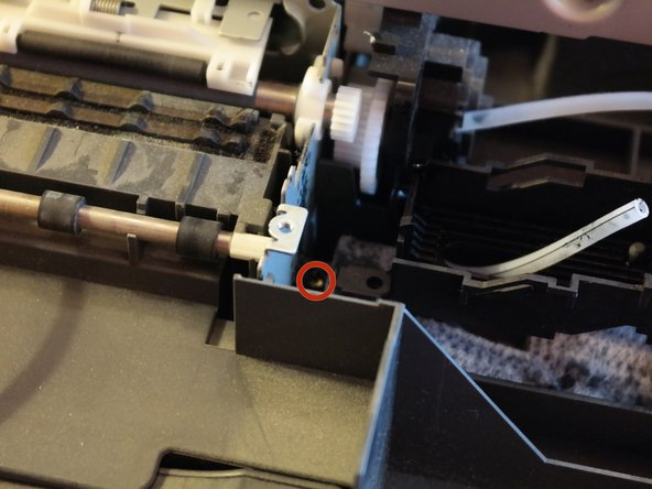 To remove the metal midframe of the printer, three screws must be removed.