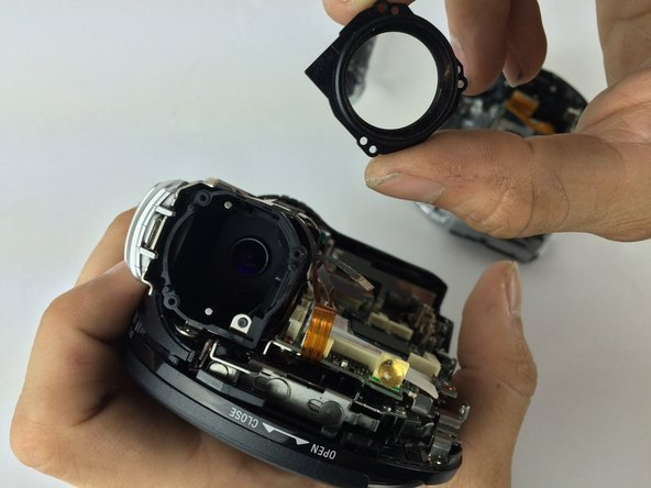 "Remove front lens and inspect for ""dirt,"" smudges. or scratches. Use discretion, if lens appears too damaged, replace part."