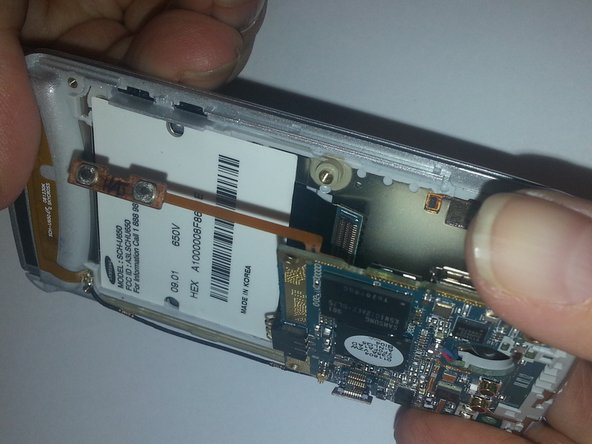 Grasp the sides of the motherboard and gently rock back and forth .  This is due to the sticky tape that is on the battery